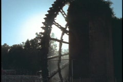 A waterwheel turns at a mill in Hama, Syria. Stock Footage