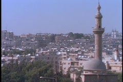 Satellite dishes dot the rooftops in Alleppo, Syria. - stock footage