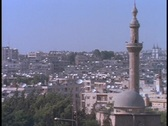 Stock Video Footage of Satellite dishes dot the rooftops in Alleppo, Syria.