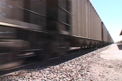 The cars of a freight train pass along the iron tracks. Stock Footage