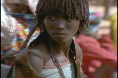 An African woman shops in an open market. Stock Footage