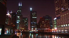 A commuter train moves slowly across the brilliant Chicago skyline Stock Footage