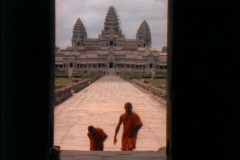 Buddhist monks walk up the stairs of Angkor Wat. Stock Footage