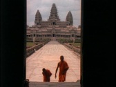 Stock Video Footage of Buddhist monks walk up the stairs of Angkor Wat.