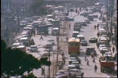 A city in Africa bustles with traffic on a city street. Stock Footage