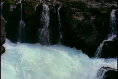 Water cascades down a water fall. Stock Footage