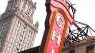 Stock Video Footage of The camera pans down the Chicago Theater's colorful marquee.