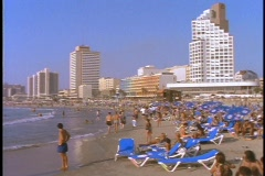Crowds relax on a beach in Tel Aviv, Israel. Stock Footage