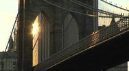 The Brooklyn Bridge's gothic-arches just catch the reflected Stock Footage