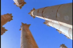 Ancient Roman pillars stand out against a blue sky. Stock Footage