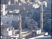Mosque towers rise above downtown Amman, Jordan. Stock Footage