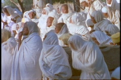 Ethiopian Coptic priests and other worshipers pray in Axum, Ethiopia. Stock Footage