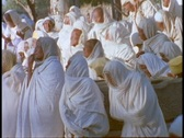 Stock Video Footage of Ethiopian Coptic priests and other worshipers pray in Axum, Ethiopia.