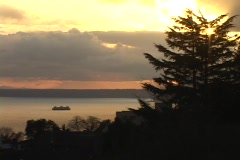 A ferry boat cruises on Puget Sound in Seattle, Washington. Stock Footage