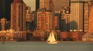Sailboats pass each other on a bright sailing day with Manhattan Stock Footage