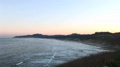 The tide rolls into a small inlet with rocks Stock Footage