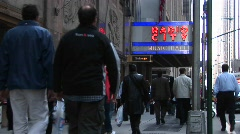 Medium-shot of people walking under the Radio City Music Hall Stock Footage