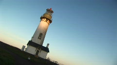 The camera takes an angled shot of this lighthouse on a sunny day Stock Footage