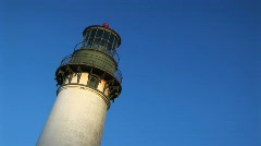 A telephoto view of the top of a lighthouse and its circular decks Stock Footage