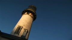 A montage of an old lighthouse at a jaunty angle in the sunlight - stock footage
