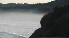 Mist rises above the ocean near the shore Stock Footage