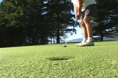A man putts and the ball goes into the hole. Stock Footage