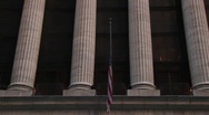 The camera pans up the columns of the New York Stock Exchange Stock Footage