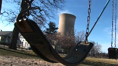 A child's swing, residential homes, and a nuclear power plant Stock Footage