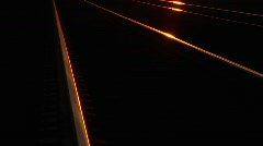 Railroad track glow in the golden-hour sunlight. Stock Footage