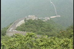 The Great Wall of China stretches across a mountain range. Stock Footage