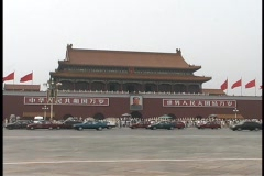 Traffic drives through Tiananmen Square near The Great Hall. Stock Footage