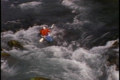 A kayaker plunges down steep rapids. Stock Footage