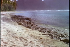 Gentle waves roll onto a tropical beach in American Samoa. Stock Footage