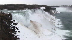 A look at Niagara Falls in winter with frozen mist forming giant Stock Footage