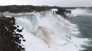 Stock Video Footage of A look at Niagara Falls in winter with frozen mist forming giant