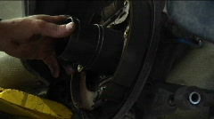 Close-up of a mechanic works on a wheel repair Stock Footage