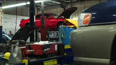 Cars in for repairs and a customer in the background Stock Footage