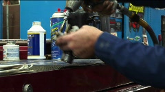 Close-up of a mechanic removing bolts from a part with a power-tool Stock Footage