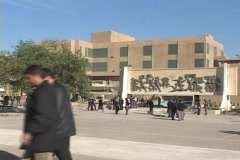 Students walk through the campus of a school in Baghdad. Stock Footage