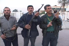 Iraqi men proudly pose with  their weapons in Baghdad, Iraq. Stock Footage