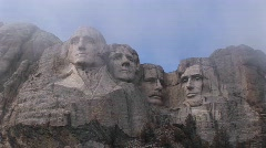 A look up at Mt Rushmore before all the mist has dissipated Stock Footage