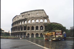A vendor sells souvenirs next to the Coliseum in Rome. Stock Footage