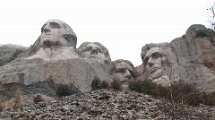 A worm's eye montage of Mt Rushmore from unusual perspective Stock Footage