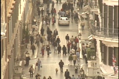 Taxis weave in and out of crowds of pedestrians on a narrow street in Rome, Stock Footage