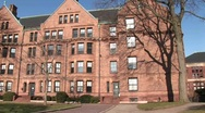 Stock Video Footage of The camera pans across some of the buildings on Harvard's campus.