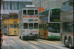 Double decker buses pass each other on a busy street in Hong Kong, China. Stock Footage