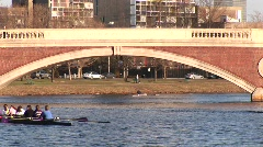 A women's rowing team crosses the Charles River during practice. Stock Footage
