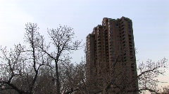 A residential high-rise is shown in winter with bare trees Stock Footage