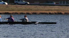 A women's team heads down the Charles River for rowing practice. Stock Footage