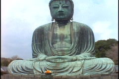 A giant Buddha statue sits in a garden in Kamakura, Japan. Stock Footage